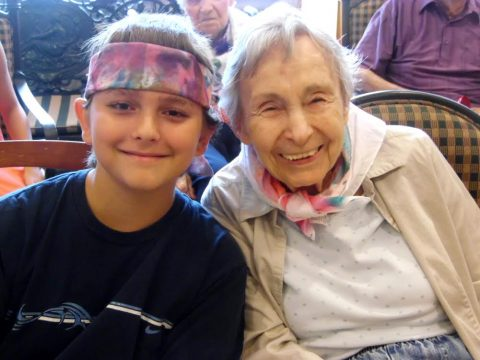 Young Man and Senior Resident enjoy Intergenerational Music Camp at Parc Provence