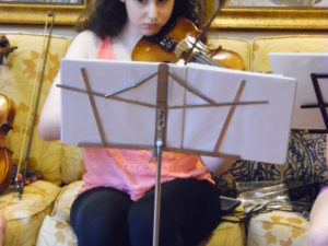 Volunteers Delight Residents with Musical Performance