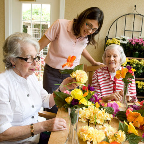 Caregiver with memory care residents who show surprise