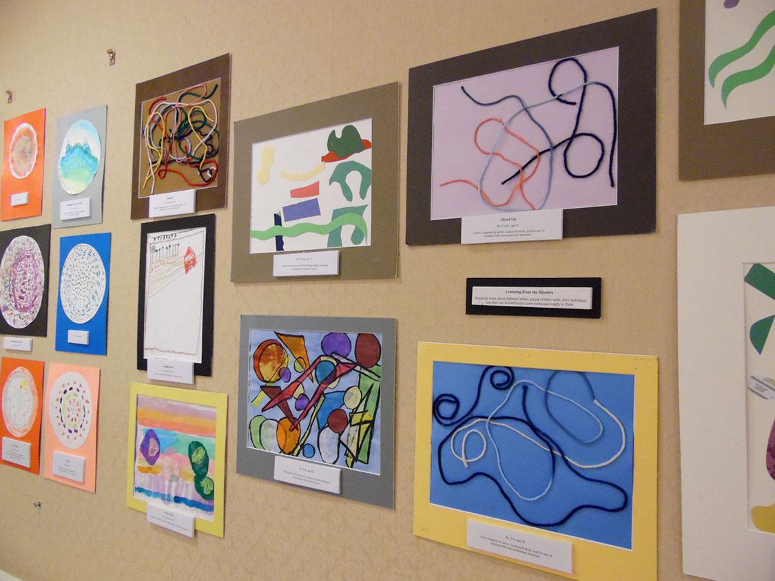 A wall full of artwork