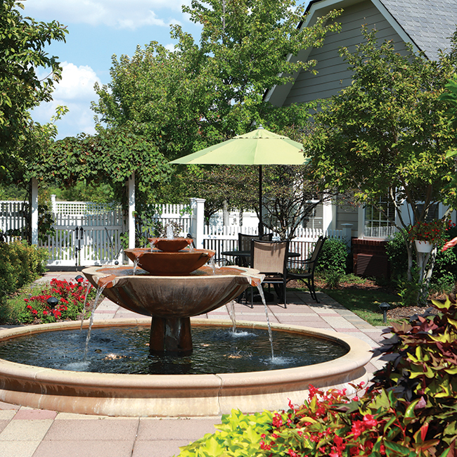 A fountain in the middle of a beautiful outdoor patio