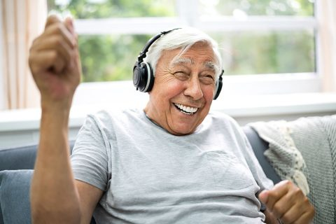 Man smiling with headphones on